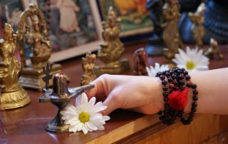 offering flowers at alter - puja - toronto sivananda yoga