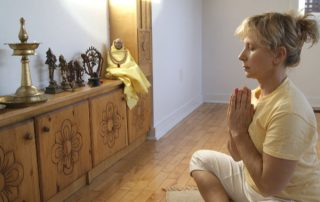 Yogini at alter - Toronto Sivananda Yoga Centre