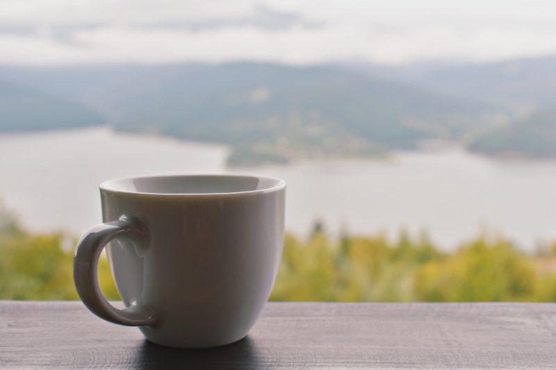 coffee cup mountain view - sivanada yoga toronto