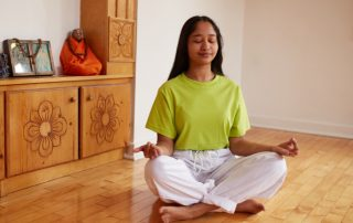 girl in meditation - sivananda yoga toronto