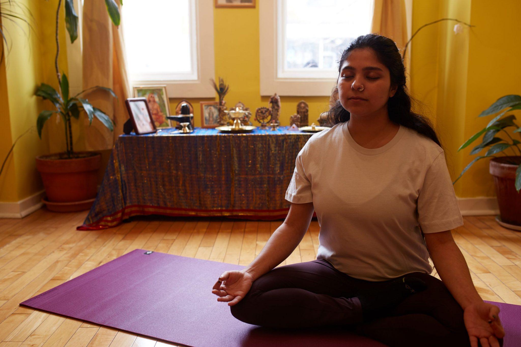 student in meditation